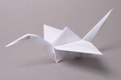 Origami crane. On gray background stock photography