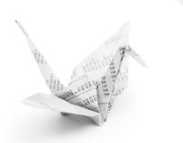 Origami crane bird from recycle newspaper Stock Images