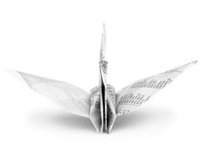 Origami crane bird from recycle newspaper Stock Image