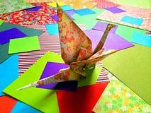 Origami crane. Colorful origami crane on vivid paper background stock photo