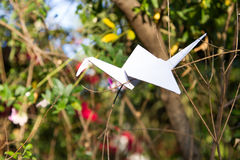 Origami crane in plant nature setting Royalty Free Stock Photos
