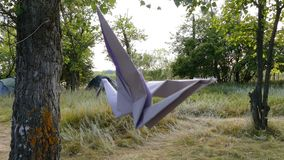 Origami crane in the wind. 4k stock video footage