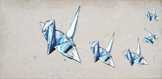 Origami cranes. Origami crane sketches on concrete background Royalty Free Stock Photography