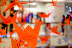 Origami cranes hanging from a thread Royalty Free Stock Photos