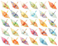 Origami cranes pattern. 30 different paper birds isolated on a white background royalty free stock photo