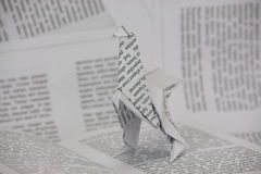 Origami dinosaur coming out of a book Royalty Free Stock Photography