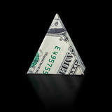 Origami dollar pyramid. Money symbol business on a black background Royalty Free Stock Photos