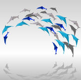 Origami dolphins. Illustration of paper dolphins in a jump Royalty Free Stock Image