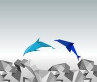 Origami dolphins. Stock Photos