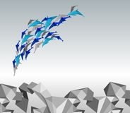 Origami dolphins. Stock Images