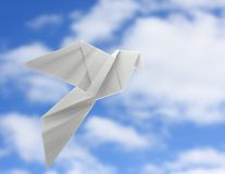Origami dove. On sky background Stock Photography