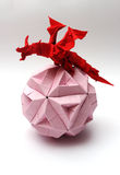 Origami dragon on paper ball Royalty Free Stock Images