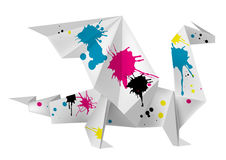 Origami dragon with splashes of ink Stock Photos