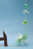 Origami elements and hammer Stock Images