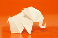 Origami elephant. Paper origami elephant on a colorful background royalty free stock images