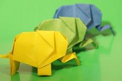 Origami elephant. Paper origami elephant on a colorful background royalty free stock image
