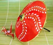 Origami et parapluie Photographie stock libre de droits