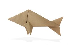 Origami fish. From recycled paper on white background Royalty Free Stock Photos