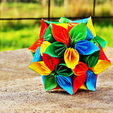 Origami flower ball. Vibrant coloured decorative origami flower ball stock photos