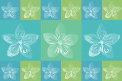 Origami flower. On blue and green background royalty free stock photos