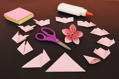 Origami flower instruction. Origami flower step by step instruction. Black background royalty free stock photos