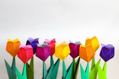 Origami flowers. Focus on the front row of the flowers. Top half of the photo was left empty intentionally Royalty Free Stock Photos