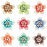 Origami flowers. 9 isolated origami flowers (handmade), different colours, on a pure white background stock photos