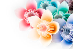 Origami flowers. Multi colour origami flowers on a white background royalty free stock photos