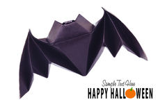 Origami flying bat. Origami paper halloween flying bat on a white background Stock Photos