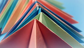 Origami  forms. Origami paper forms in bright, pastel colors Stock Image