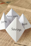 Origami fortune teller. On financial paper showing share prices royalty free stock images