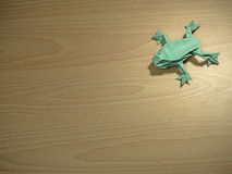 Origami Frog on wooden background Royalty Free Stock Image