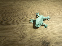 Origami Frog on wooden background Royalty Free Stock Images
