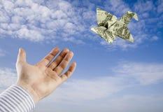Origami Geld-Vogel Stockfoto