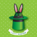 Origami Green Greeting card with Happy Easter - with Black Easter rabbit - green sunglasses,hat. Royalty Free Stock Photo