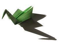 Origami green swan with shadow isolated on black Stock Photo