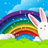 Origami Greeting card with Happy Easter - with white Easter rabbit and rainbow. Stock Photo