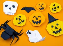 Origami Halloween. Bat, ghost, pumpkin, paper stock photo