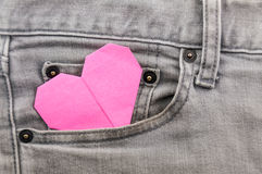 Origami heart in grey jean pocket Royalty Free Stock Photography