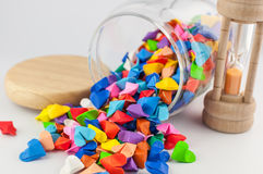 Origami heart in jar with sandglass Royalty Free Stock Photo