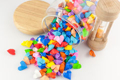 Origami heart in jar with sandglass Stock Images