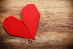 Origami heart on wooden background Stock Photo