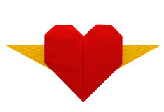 Origami heart with yellow wings isolated over white background Stock Photography
