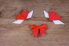 Origami hearts with wings on a wooden background. Two hearts Royalty Free Stock Images