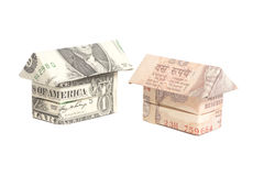 Origami house made of 100 dollar and Indian rupee banknotes Royalty Free Stock Images