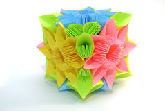 Origami kusudama. Colorfull origami unit Blue, yellow, pink flower isolated on white Royalty Free Stock Photo