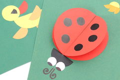 Origami of ladybug and duck from recycled paper Stock Image