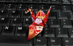 Origami on a laptop keyboard Royalty Free Stock Photo