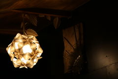 Origami lights. Handmade modular origami lampshade and origami leaves Stock Image