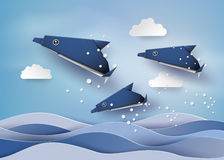Origami made dolphin in the sea. Royalty Free Stock Photo